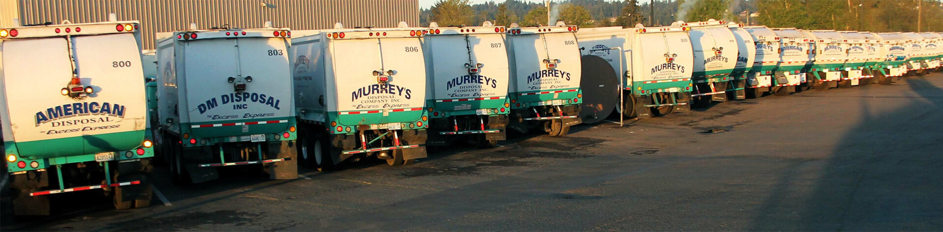 Waste Connections - Murrey Disposal waste hauling trucks.